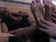 Blonde slut gets an oily foot massage