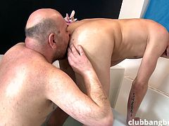 This fresh twink really had good time in the bathtub. Experienced bald gay undressed in front of him and joined him in the water. He fingered twink's butt hole and licked it wholeheartedly. Then, he decided to destroy that small ass hole with his hard cock.