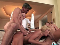 Blonde housewife brings her husband to a porn set where he and a male pornstar fuck his wife and cum on her face.