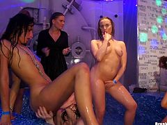 An on stage shower turns into a five girl lesbian orgy