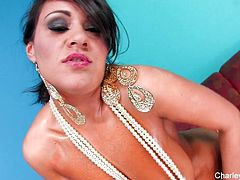 Charley Chase pours oil all over her sexy body