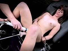 Dildo machine and a petite girl have hot sex