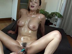 Fucking hot oiled up chick Rei Kitajima gets her pussy toyed and takes jiss in her mouth