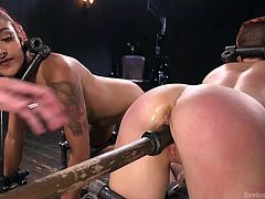 These two redhead sex slaves are placed in a special device bondage, one near the other. The master starts his deal with ebony babe, making her to suck on a dildo. Then, this lubricated dildo will be shoved in another slave's pussy and then, again in ebony's mouth, to make her to taste her mate's pussy juices