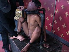 Nikki's executor wraps her entire head with duct tape, leaving her completely blind and breathless, save for a tube in her mouth. She can't move, thus she must take his teasings with those electric toys.