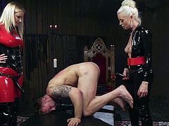 Tanner Tatum was ordered to suck two huge strap-on dicks and he obliged. These two busty blondes took turns to fuck his tight butt hole with huge strap-ons and both of them ignored his painful screams. Cock and Ball Torture in this session is too unbearable and this is must watch for BDSM lovers.