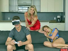 Blonde milf Corey had the bright idea to fuck her stepdaughter's boyfriend right in front of her. Put down the virtual reality headset, because your about to get fucked by your girlfriend's hot stepmom. All this happened while the girlfriend was on the same couch, taking a nap.