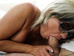 Milf takes guys rock solid meat stick in her mouth