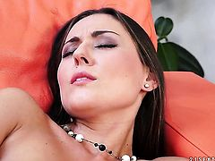 Brunette displays her naughty parts before she plays with herself