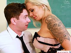Miss Elle is as caring about her students' education, as she is unbelievably hot. Brad has been acting up, and she knows he has great potential, if he'd only focus and apply himself. She started seeing if he'd focus on her tits, and he did very well.