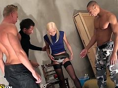 Betsey Kite wanted to earn some extra money and these guys were ready to pay a good amount for a gangbang. They stripped down the russian babe and rubbed her ass. One was fucking her mouth, another was squeezing her breasts, while the third guy was receiving a handjob. They drilled her holes simultaneously.