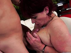 Redhead with giant hooters shows her slutty side to hot dude by taking his stiff rod in her mouth