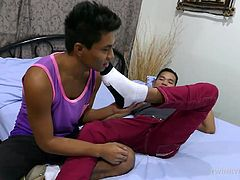Having more than just their name in common, these two gay Asian boy love male feet and foot worship. The two horny twinks slip off their shoes and socks and start sniffing. This gets them horny as they get naked and start sucking toes. And thats not all theyre sucking. The Asian boys make sure to exchange blowjobs in between foot fetish activities. Soon the male feet action has them fucking bareback. The Asian feet buddies fuck themselves into shooting their cum.