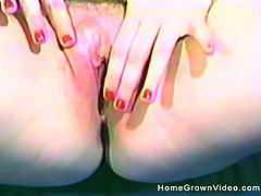 Blonde with a shaved cunt loves exploring it with her fingers
