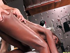 Brunette chocolate Richie Calhoun with massive breasts and shaved twat shows it all for camera
