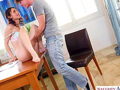 Lucie's petite body is so tight, that when she kneels down in front of him and whips his cock out, it makes it look even bigger. She has no trouble pushing Rion's fat manhood far down her throat and this makes her tight pussy even wetter. She can't wait for him to take her right on that table!