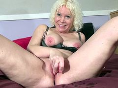 Mature blonde Therese C masturbating
