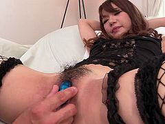 Hot finger fucking and vibrator play for a bound Asian