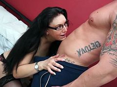 Curvaceous black-haired cougar Sabrina is hungry for the taste of cock, and she's about to show this tattooed stud just how much she's lusting for him. Pulling down her lacy black bra, to reveal unbelievably huge tits, she gets on her knees and strokes his throbbing boner with her warm mouth.