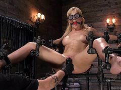 If you like seeing hot helpless women enjoying hard metal bondage, then this is the right place for your wishes come true. Blonde busty milf Cherie Deville was really horrified, sitting in this dark dungeon in one special metal bondage device, but her master fingered her wet pussy and made her cum in no time