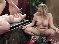 When you have one sexy blonde tied up, and another one positioned in a squat on a vibrator, you can do pretty much anything you want, such as smack them with a riding crop. John does just that to both Angel and Chloe, as well as fucking Chloe's ass and pussy.