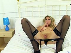 Ashleigh is a stunning milf with long blonde hair and an insatiable appetite for sex. She is all alone and ready to please herself. The naughty and elegant blonde slides her fingers down into her cunt and she makes herself cum hard. She loves to masturbate.