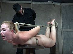 How much torture will sexy blonde Samantha be able to handle from the master. He has her tight up tightly in rope in the dungeon, and he is making it more painful, by pulling on it and making it tighter.
