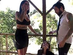 The mistress and master have a cute sex slave to please their every whim. She has to suck his cock and eat her pussy, because she must obey. They are in charge of her sexual tasks. She is gagging on big dick and slobbering all over it.