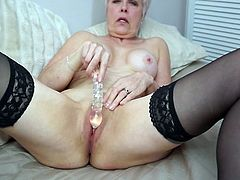 This old lady wants to show off her amazing pussy for you. Her legs are spread and she flashes her mature cunt. Look at how much fun she is having with her dildo. It goes deep in her twat and in between her saggy boobs.