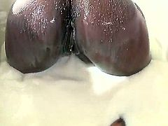 Naked ebony chick Tori Taylor plays with her huge black tits  and then gives interracial blowjob to lucky white guys, Busty ebony eats his sausage with appetite and can't get enough.