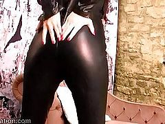 Stunning brunette strips off tight leather catsuit fucks toy