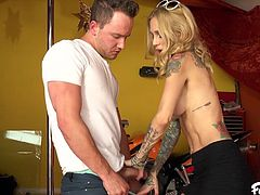 She went to the repair shop to get her motorcycle fixed, but she forgot her purse, so she couldn't pay. That's ok, because she can give the mechanic a blowjob instead. Sexy blonde Sarah sucks off that big cock and gets ready to take a big load down into her throat. She deepthroats that cock.