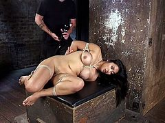 Slutty Asian chick Mia Li is suspended and punished by one kinky dude