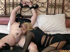 Asian ladyboy mistress Barbie binds guy's hands to the headboard and gives him a blowjob. Barbie strokes her dick and fucks ass with anal beads during the blowjob process.
