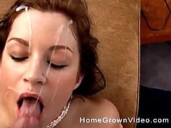 Pretty chick's face sprayed with semen after a blowjob