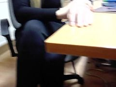 Office secretary young wife in black suit open legs