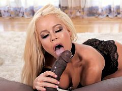 Posh blond milf Nikki Delano guzzles a hard black dick greedily