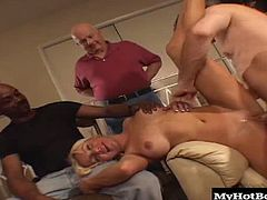 He cant get it up and rather than to lose his gorgeous, blonde haired wife, who has big melons and a shaved pussy, he agrees to let her fuck and suck two studs in a MMF hardcore, threesome while he sits and watches, right up to the final facial cumshots.