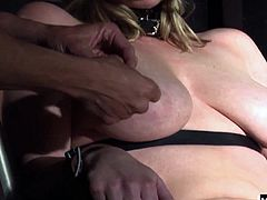 Hes grown tired of this dumb blonde giving him demands, so he treats her to some punishment He cinches some cuffs around her wrists, and straps her in ways that she cannot touch herself, and is at his mercy for her orgasms.