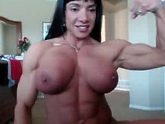 Muscle woman showing her big clit
