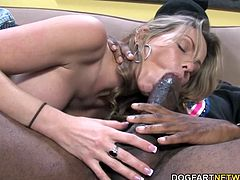 Big titted Courtney sucks and deepthroats Jack's big black cock. After blowjob she experiences real interracial sex. She screams while Jack pounds her pussy...