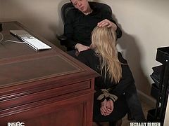 Riley's work place is under her boss's table, sitting on her knees and sucking his dick. At such times her hands are usually tied behind her back and her main duty is to swallow her boss's big cock as deep as possible