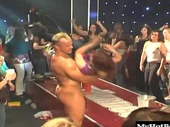 These strippers have amazing staying power taking on chick after chick as throngs of ladies look on and watch. A few in the crowd start playing with each other for an added bonus of hot lesbian action.