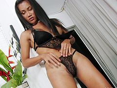 It's not hard to figure out that Ploy's favorite color is black. From her hair to her lingerie, she loves black. It makes her feel sexy, and she really gets into it as she gets naked and shows all of her body, making it a point to show off her tight asshole, which she wants to be filled with cock.