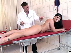 Tricky doctor provide her some internal treatment...He is eating her juicy tits and poking her pussy with medical instrument.