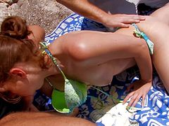 Slutty Leane Fontaine receiving two stiff cocks at the beach