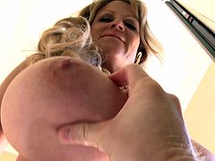 Solo model Kelly with fake tits fingering her pussy