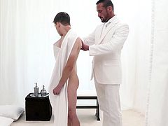 Elder Dalton is still reeling from having just been fucked and is now told to meet with President Lee! The handsome muscle daddy washes and prepares the boy to be inducted into the Order, fully aware of the boy's highly aroused state. The older priest leader gladly takes the boy into his arms, kissing him and touching him everywhere he can… all to get him ready for a deep, raw penetration of his thick, meaty cock!