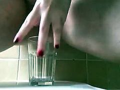 Nice BBW pussy easily fills a glass full of warm pee 1