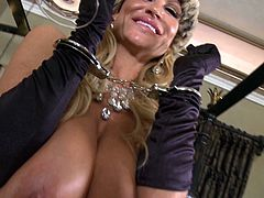 Kelly Madison wears hot lingerie while playing with her tight pussy